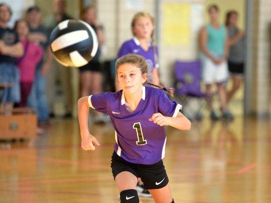 Kate Collins' Lindsey Painter chases a ball during her team's match in the Staunton City Showdown Tournament.