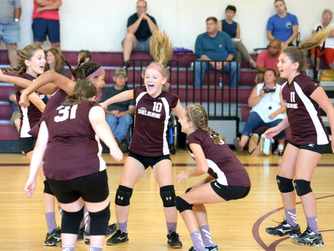 Shelburne Middle School players celebrate a point during