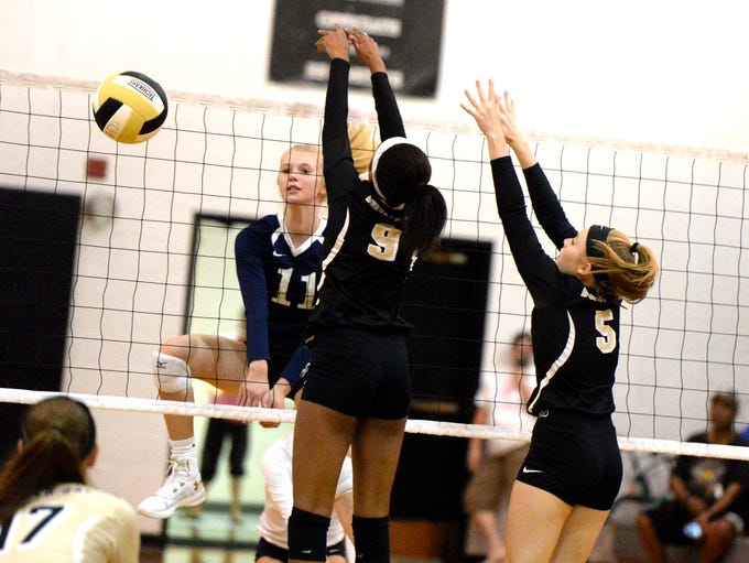 Lee High's Lillian Kopia gets her attack past the block