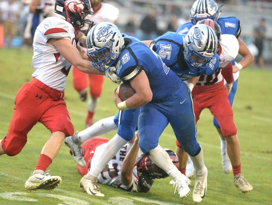 Lee High's Garrett Lawler fights off an East Rockingham