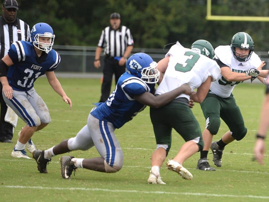 Fort Defiance's Traevon Winston takes down Monroe's