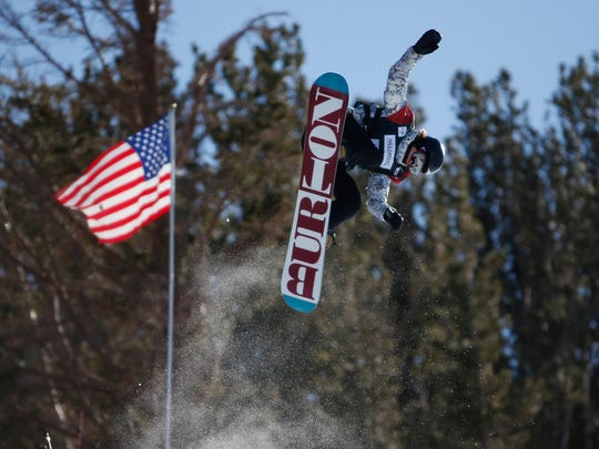 Pro snowboarder Kelly Clark soars above the halfpipe on her way to a first-place finishat Mammoth Mountain on Jan. 24. Clark, 32, won the event by beating out 15-year-old sensation Chloe Kim, who placed second.