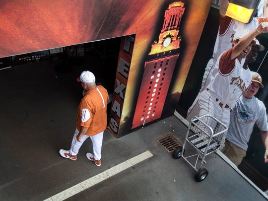 Texas coach Augie Garrido walks into the team clubhouse after the Longhorns defeated Baylor 7-6 in a college baseball game in Austin, Texas, on Saturday, May 21, 2016. (Rodolfo Gonzalez/Austin American-Statesman via AP)