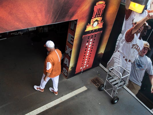 FILE - In this Saturday, May 21, 2016, file photo, Texas coach Augie Garrido walks into the clubhouse after the Longhorns defeated Baylor 7-6 in an NCAA college baseball game in Austin, Texas. Garrido, the winningest coach in college baseball history, is out after 20 seasons at Texas. The decision Monday, May 30, 2016, comes after the Longhorns' first losing season since 1998. (Rodolfo Gonzalez/Austin American-Statesman via AP, File)