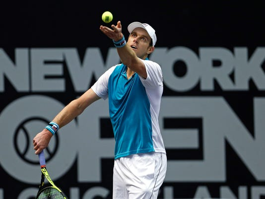 Sam Querrey serves to Adrian Mannarino, of France, during their semifinals match at the New York Open tennis tournament in Uniondale, N.Y., on Saturday, Feb. 17, 2018. Querrey defeated Mannarino in the match. (AP Photo/Adam Hunger)