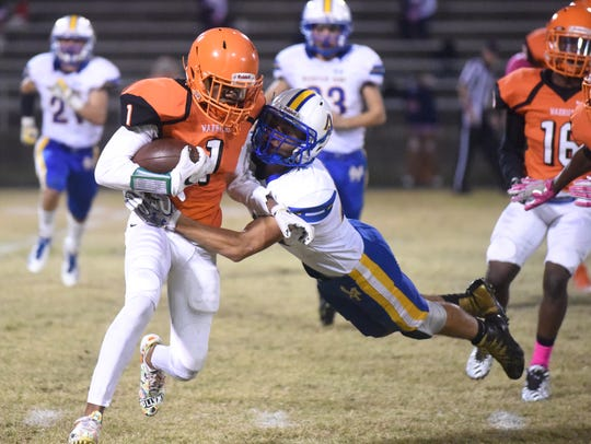 Mountain Home's Logan Crim makes a flying tackle of