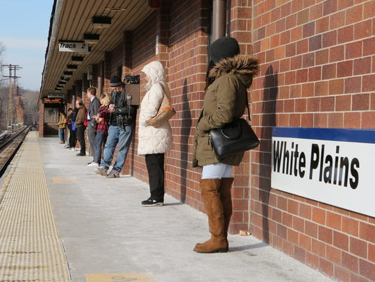 Young adults wait for a southbound train Saturday at