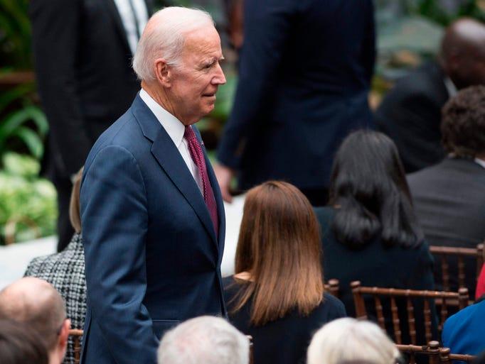 Former Vice President Joe Biden arrives for the unveiling
