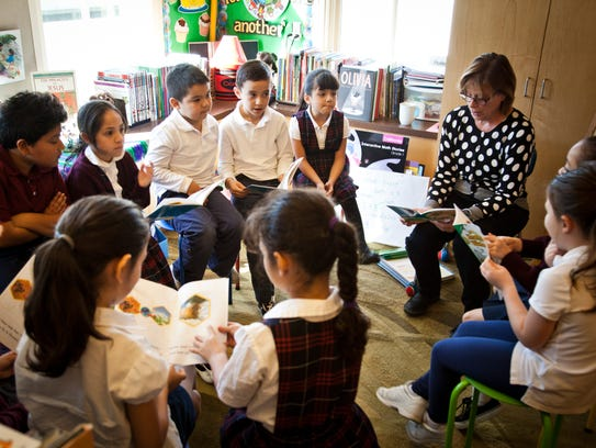 Sister Susan Ostrowski teaches a group of first-graders