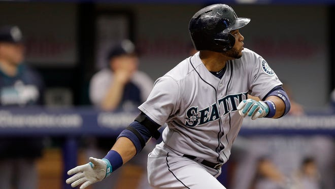 The Mariners' Robinson Cano hits a two-run single off Rays starting pitcher David Price on Monday. The former Yankee is hitting .330 for Seattle this season.