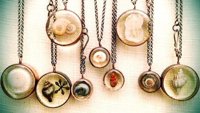 Resin shell necklaces are the work of Evelyn Taylor Bonner, an organizer of The Camden County Art  Alliance.