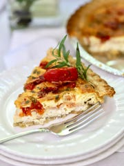 A piece of Roasted Tomato Quiche with Goat Cheese.