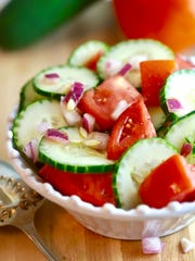 Dressings of vinegar and olive  oil finishes Cucumber