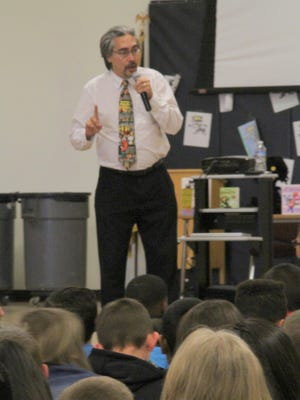 """""""Bad Kitty"""" author and illustrator Nick Bruel talked to Yucca Elementary School students Wednesday. Bruel will be talking at schools in Alamogordo, Tularosa and Cloudcroft with his visit culminating at book signing event at Yucca Elementary School, 310 Dale Scott Ave., between 3:30 p.m. and 5 p.m. Friday."""