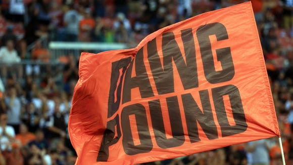 Dawg Pound flag after a touchdown during the first quarter of a preseason NFL football game in August of 2015.