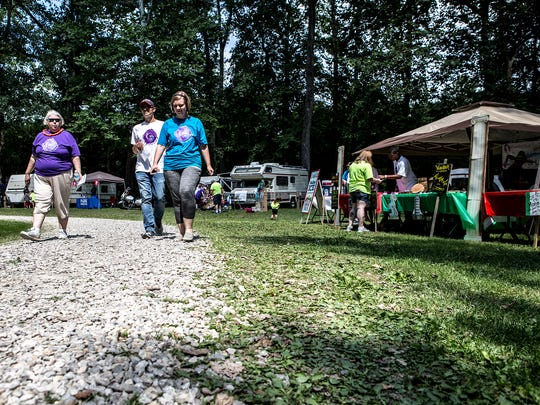 Gladys Haney, Michael Styer and Sara McMaster walk around the drive at The Grove by the River Saturday as they participate in Relay for Life. All three have had family members and friends who have battled cancer so it was important to all of them to join the PNB team and help raise money.