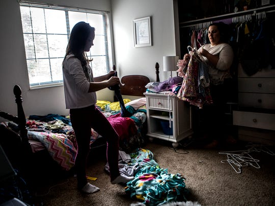 Caity and Lera spend an afternoon cleaning and putting clothes away. The amount of laundry Caity and her husband now have to do has increased substantially after adopting Lera and her three younger brothers from the Ukraine.