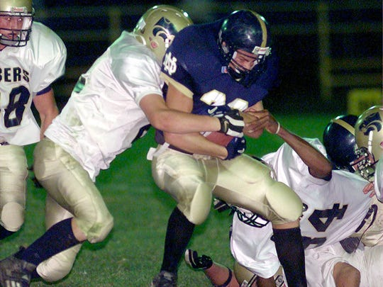 Notre Dame's Caleb Norton carries the ball against