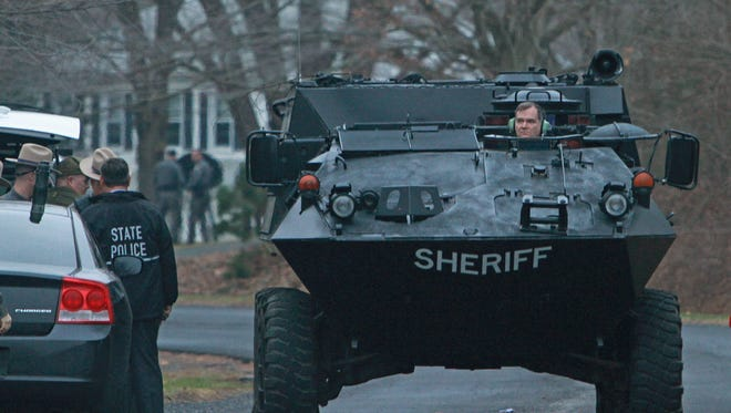 Putnam County Sheriff Emergency Response Team armored vehicle drives down Nichols Road in Southeast as sheriff deputies and New York state troopers surround a home on Nichols Road in the town of Southeast after a subject in the home fired shots at police.