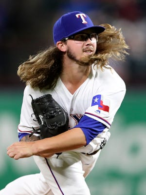 Texas Rangers relief pitcher Zac Curtis throws during the sixth inning against the Tampa Bay Rays at Globe Life Park in Arlington.