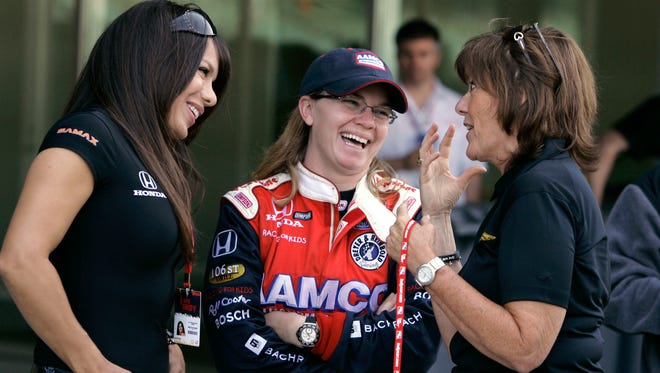"A crash between Sarah Fisher, center, and Lyn St. James, right, in the 2000 Indy 500 was labeled a ""cat fight"" by an ESPN writer. At left is driver  Milka Duno of Venezuela."