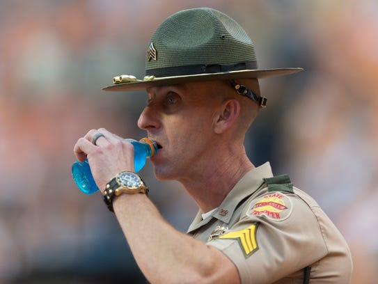 Tennessee State Trooper Turley takes a drink during