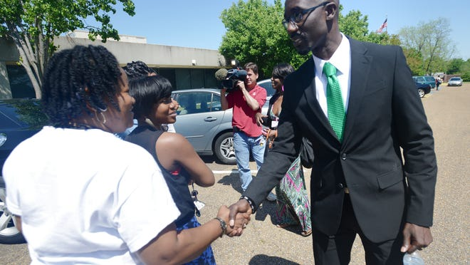 Jackson Mayor-elect Tony Yarber greets a group of women while at the Hinds Community College Academic and Technology Center in Jackson to speak at a M2M Minority Male Leadership Initiative advisory board meeting on Wednesday.