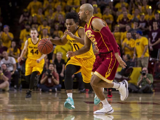 Arizona State's Tra Holder drives down court against