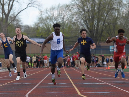 Salem's Andrew Davis wins the 100 meters at the second