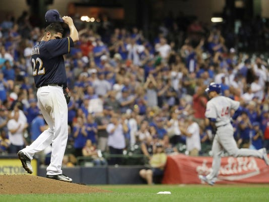 Milwaukee Brewers starting pitcher Matt Garza wipes his head after giving up a home run to Chicago Cubs' Anthony Rizzo (44) during the sixth inning of a baseball game Wednesday, Sept. 7, 2016, in Milwaukee. (AP Photo/Morry Gash)