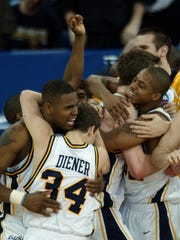Marquette's Robert Jackson (left), Travis Diener, Steve Novak and Joe Chapman celebrate their 101-92 overtime win over Missouri in a 2003 second-round NCAA Tournament game.
