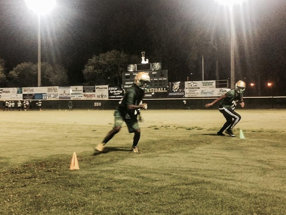 Lincoln defensive back Larry Stevens goes through agility drills during the Trojans' 24th annual Midnight Madness practice to mark the start of the fall football season.