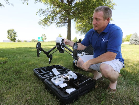 Jason Preston shows one of his drones, the DJI Inspire
