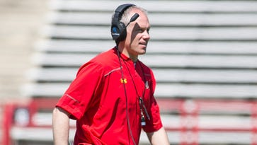 First-year Maryland coach D.J. Durkin watches from the field during the Terps' spring game.