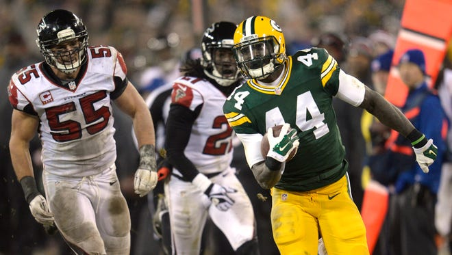 Green Bay Packers running back James Starks (44) sprints down the sidelines with Falcon defenders Paul Worrilow (55) and Desmond Trufant (21) in pursuit against the Atlanta Falcons during Monday night's game at Lambeau Field.