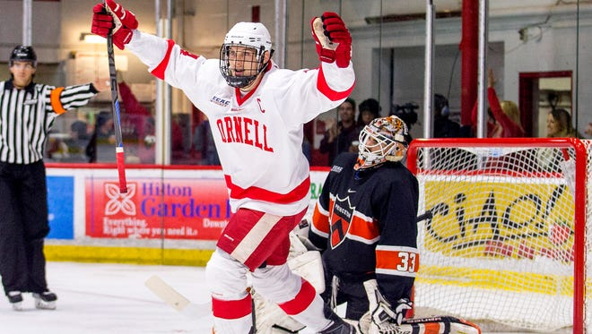 Cornell captain John McCarron celebrates in front of Princeton goalie Colton Phinney after Holden Anderson scores Cornell's third goal 5:33 into the third period. Cornell won the match against Princeton 4 - 2.