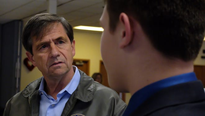 Joe Sestak, a former Navy admiral and congressman, left,  talks with Matthew Ott, 15, of West York, during a Feb. 10, 2016, campaign stop at VFW Post 5265 in Spring Grove. Matthew is trying to raise $1 million for Veteran's Challenge. (John A. Pavoncello - jpavoncello@yorkdispatch.com)