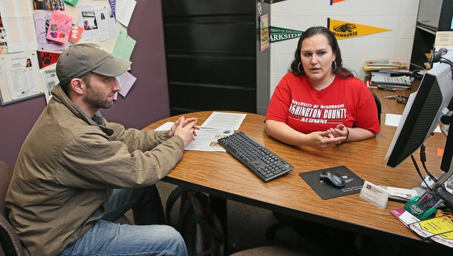 Maria Graciano, student affairs coordinator at UW-Washington County, helps Kenneth Taylor plan a transfer to Louisiana State.