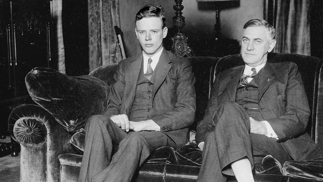 Charles A. Lindbergh (left) who in 1927 became the first man to fly solo across the Atlantic Ocean paid an unexpected visit to Indianapolis on Jan. 17 1929. He dropped by the Governor's Mansion on Fall Creek Boulevard to congratulate Indiana Gov. Harry G. Leslie who took office just three days prior.