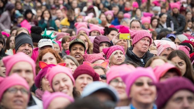 "A general view during the women's march on Washington on Saturday, Jan. 21, 2017. Many at the march wore knitted pink hats. A Tennessee knitting shop in a Facebook post Tuesday, Jan. 24, 2017, asked supporters of the ""women's movement"" to shop for yarn elsewhere."