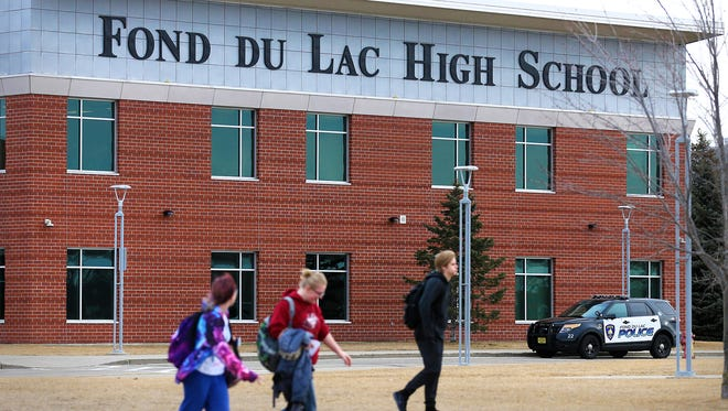 An increased police presence was seen Monday, March 5, 2018 at the Fond du Lac High School after a social media post mentioning a school shooting was discovered. Students were allowed to leave if parents chose to pick them up.