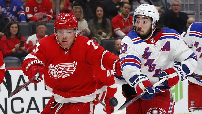Red Wings' Adam Erne, left, and Rangers center Mika Zibanejad battle for the puck in the second period of a Feb. 1 game in Detroit. The Red Wings and Rangers are Original Six teams. AP Photo/Paul Sancya