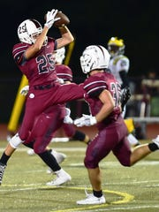 Milford's Brian Gorny makes the interception and returned