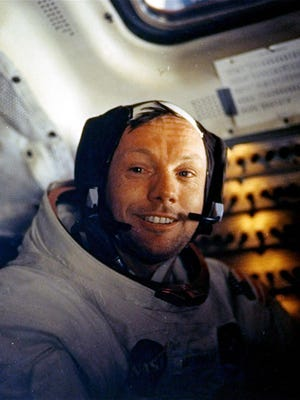 Neil Armstrong, shown here on July 20, 1969, the day he first walked on the moon, was commander of Apollo 11. The Smithsonian Institution launched its first Kickstarter campaign Monday — the anniversary of the famous mission — to conserve, display and digitize Armstrong's spacesuit.