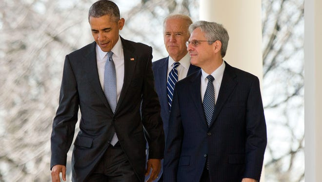 Federal appeals court judge Merrick Garland, walks out with President Barack Obama and Vice President Joe Biden as he is introduced as Obama's nominee for the Supreme Court during an announcement in the Rose Garden of the White House, in Washington, Wednesday, March 16, 2016.