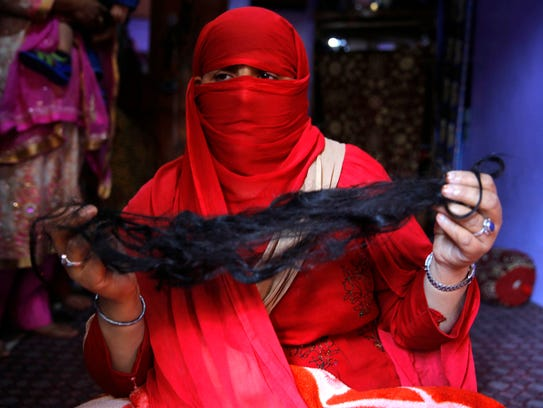 Tasleema, a Kashmiri Muslim woman, shows her hair after an alleged braid-chopping attack in the Natipora area of Srinagar in Indian Kashmir, on Oct. 17, 2017.