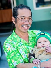 "Chingchai ""Chang"" Liampetchakul, owner of the former Tipps Thai Cuisine in downtown Ventura, poses with grandson Lorenzo ""Cheeto"" Moraza in a 2016 photo taken by a family friend. Liampetchakul died of cancer on Aug. 1."