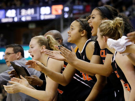 Oregon State players cheer from the bench as their team increases its lead against Washington late in the second half of an NCAA college basketball game Friday, Feb. 5, 2016, in Seattle. Oregon State won 61-53.
