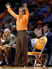Tennessee coach Holly Warlick directs her players in an NCAA college basketball game against Baylor, as she stands next to an orange chair labeled for Pat Summitt in the bench, Dec. 4.