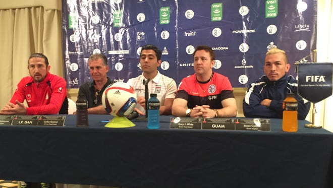 Prior to their World Cup Qualifying match, the Guam and Iran men's national soccer teams held a press conference at the Hilton Guam Resort and Spa on Monday, Nov. 16. Present were, from left, I.R. Iran captain Andranik Teymourian, Iran head coach Carlos Queiroz, a Farsi translator, Matao head coach Gary White and Matao captain Jason Cunliffe.